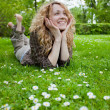 Beautiful happy woman on lawn — Stock Photo