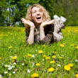 Happy surprised womon flower field — Stock Photo #5807361