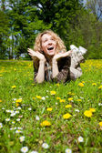 Happy surprised woman on flower field — Foto Stock