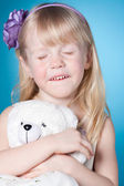 Happy dreamy little girl with toy — Stock Photo