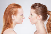 Profile of two red-haired woman — Стоковое фото