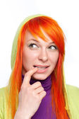 Red hair curious woman with finger at mouth — Stock Photo
