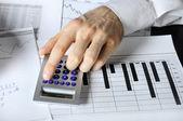 One man hands doing financial job — Stock Photo