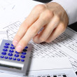 Hand working on calculator — Stock Photo #6653169