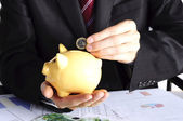 Yellow pig with coins used like piggybank — Stock Photo