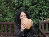 Girl eating bread — Stock Photo
