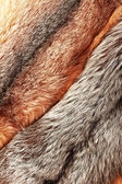 Combined silver and red fox fur background — 图库照片