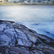 View of a rocky coast at dusk. Long exposure shot. — Stock Photo