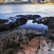 View of a rocky coast at sunset. Long exposure shot. — Stock Photo