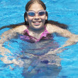Girl having fun in a swimming pool — Stock Photo