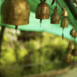 ストック写真: Bells outside buddhist temple. Vertical shot.
