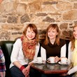 Stock Photo: Mjust arrived in caffee where three girls were expecting hi