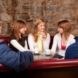 Group of five having fun in cafe — Stock Photo