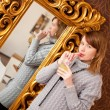 Beautiful girl infront of a mirror — Stock Photo