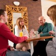 Four having a chat in a cafe — Stock Photo #6088381