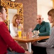 Four having a chat in a cafe — Stock Photo #6088396