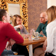Four having a chat in a cafe — Stock Photo #6088409