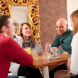 Four having a chat in a cafe — Stock Photo