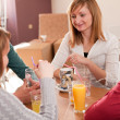 Four having a chat in a cafe — Stock Photo #6088608
