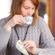 Stock Photo: First capuccino - Beautiful young caucasigirl drinking coffee