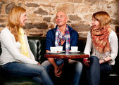Smiling drinking coffee and having fun — Stock Photo