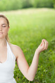 Meditation in nature - Cute young girl meditates outdoor on a gr — Foto Stock