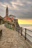 Seaside view of old church in Piran slovenia — Stock Photo