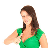 Young woman showing thumb up and smiles — ストック写真