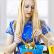Young cute woman cooking salad — Stock Photo #5413799
