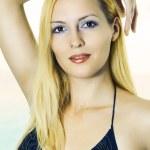 Sexual woman in bikini on a beach in summer — Stock Photo #5679412