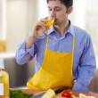 Man cooking and drinking white wine — Stock Photo
