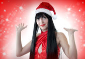 Portrait of beautiful woman in santa hat — Stock Photo
