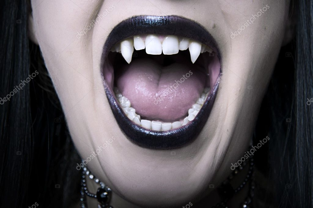 Opened mouth with long white fangs closeup of screaming vampire woman. Make up for halloween — Stock Photo #6480139