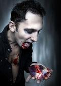 Halloween. Vampire eat heart. — Stock Photo