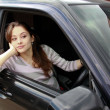 Beautiful girl is sitting in sport car and looking — Stock Photo