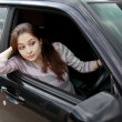 Surprising beautiful woman looking from the car to the road — Stock Photo #5474189