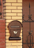 Brown letterbox on the fence — Stock Photo
