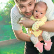 Father holding newborn joyful baby girl on the hands — Стоковая фотография