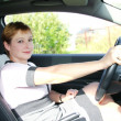 Beautiful smiling woman behind the wheel in sport car — Stock Photo #6666834
