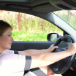 Стоковое фото: Beautiful smiling woman behind the wheel in sport car