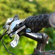 Outdoor shot of a sport bicycle control. Closeup. - Stock Photo