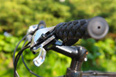 Outdoor shot of a sport bicycle control. Closeup. — Stock Photo