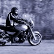 Man riding a motorcycle on the road — Stock Photo
