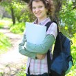 Female Teenage Student In Park - Stockfoto