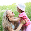 Mother and her daughter in the park on a sunny day — Stock Photo #5674577