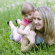 Mother and her daughter in the park on a sunny day — Stock Photo #5674579