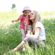 Mother and Daughter Blowing Dandelion Seeds Together — Stock Photo