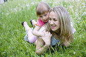 Mother and her daughter in the park on a sunny day — Stock Photo