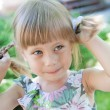 Beautiful little girl with pigtails — Stock Photo