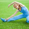 Attractive Woman stretching before Fitness and Exercise - Stock Photo